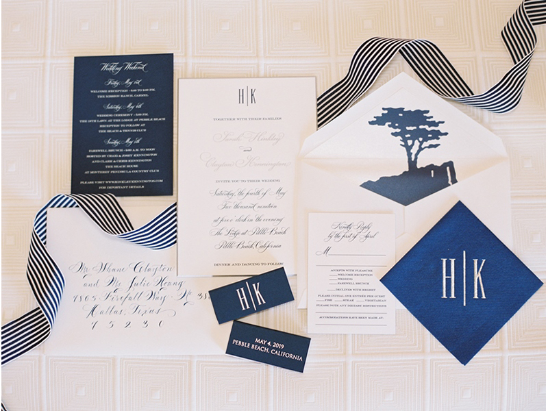 Close up of wedding invitation suite layout with blue and white details, Lone Cypress envelope liner