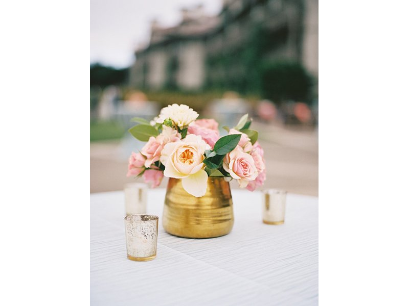 Small floral arrangement in gold vase