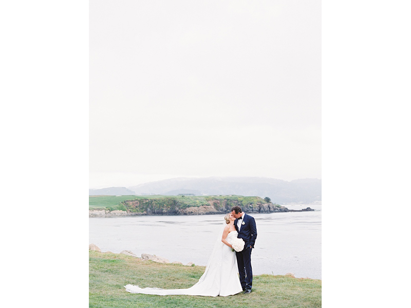 Bride and groom kissing at Pebble Beach Golf Links