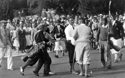 Bobby Jones shaking hands on the golf course