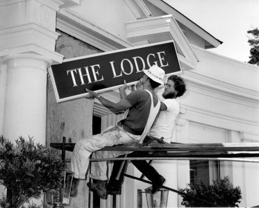 Men putting up The Lodge sign at Pebble Beach