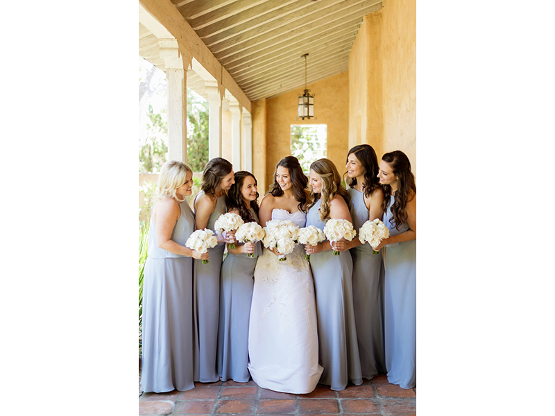 Bride with bridesmaids in grey holding white bouquets
