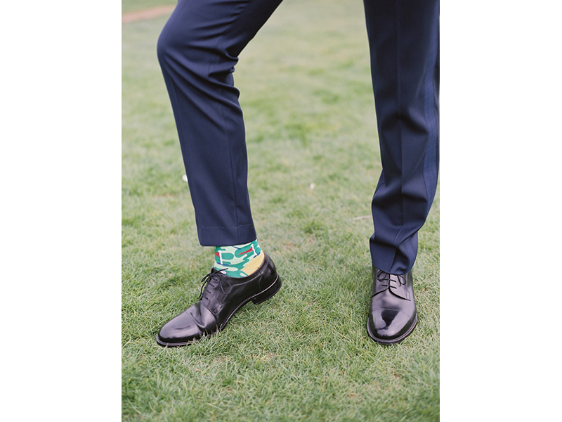 Close-up of groom's golf-themed sock