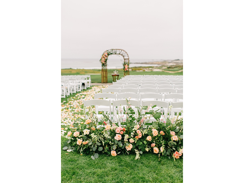 Empty wedding ceremony setting with flowers