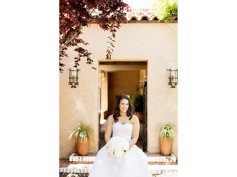 Bride sitting at Casa Palmero holding bouquet