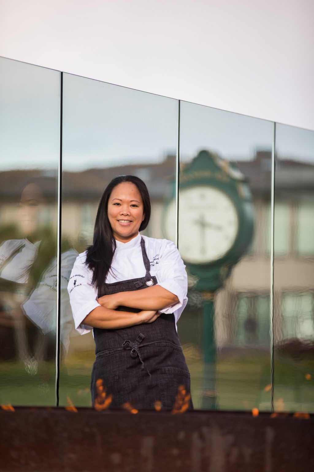 Chef Anna Marie Bayonito poses on the patio of STICKS restaurant at The Inn at Spanish Bay.