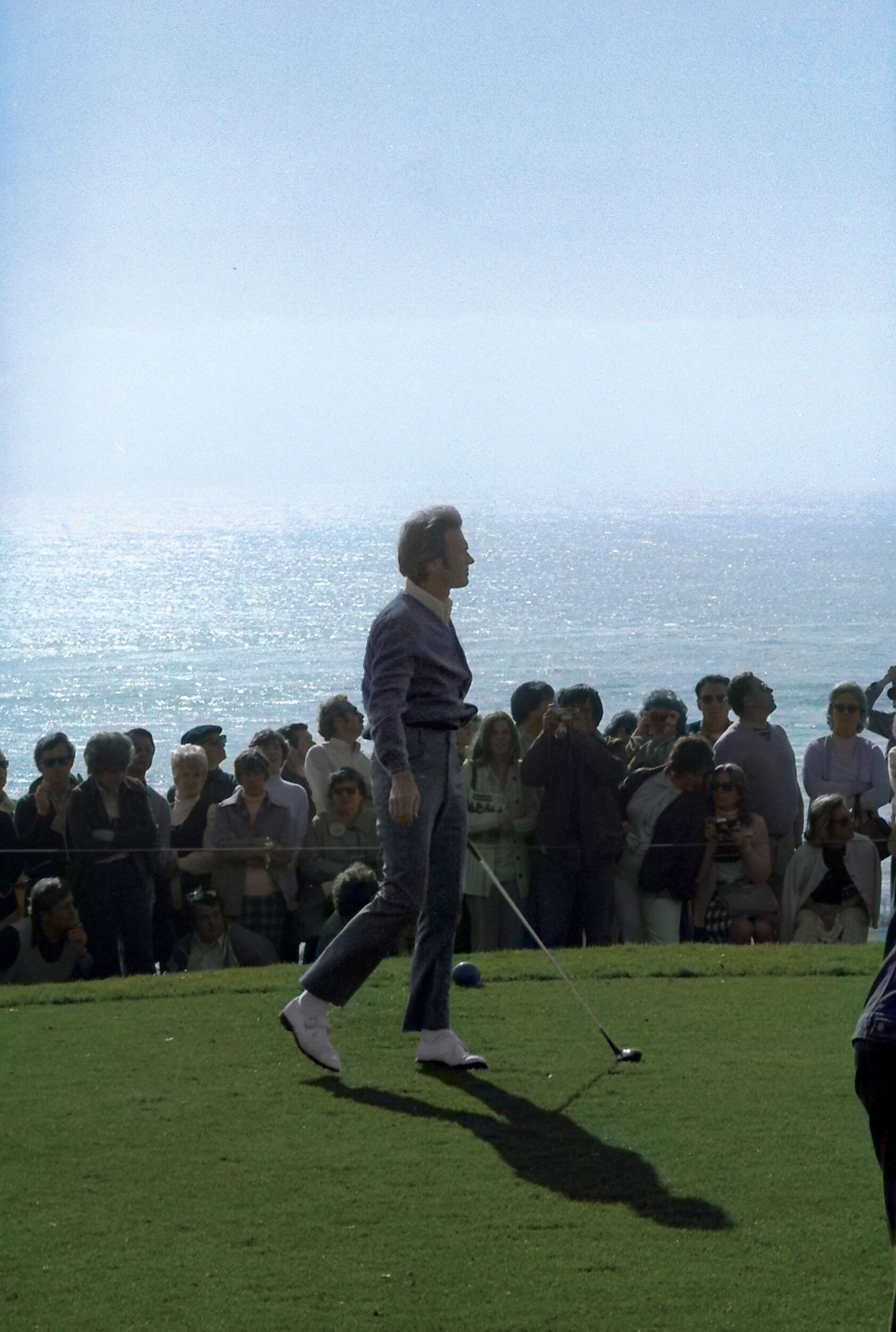 A young Clint Eastwood tracks his tee shot down the fairway at the AT&T Pebble Beach Pro-Am.