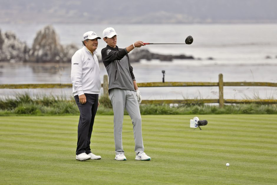 Pro and Junior Golfer on 18th tee