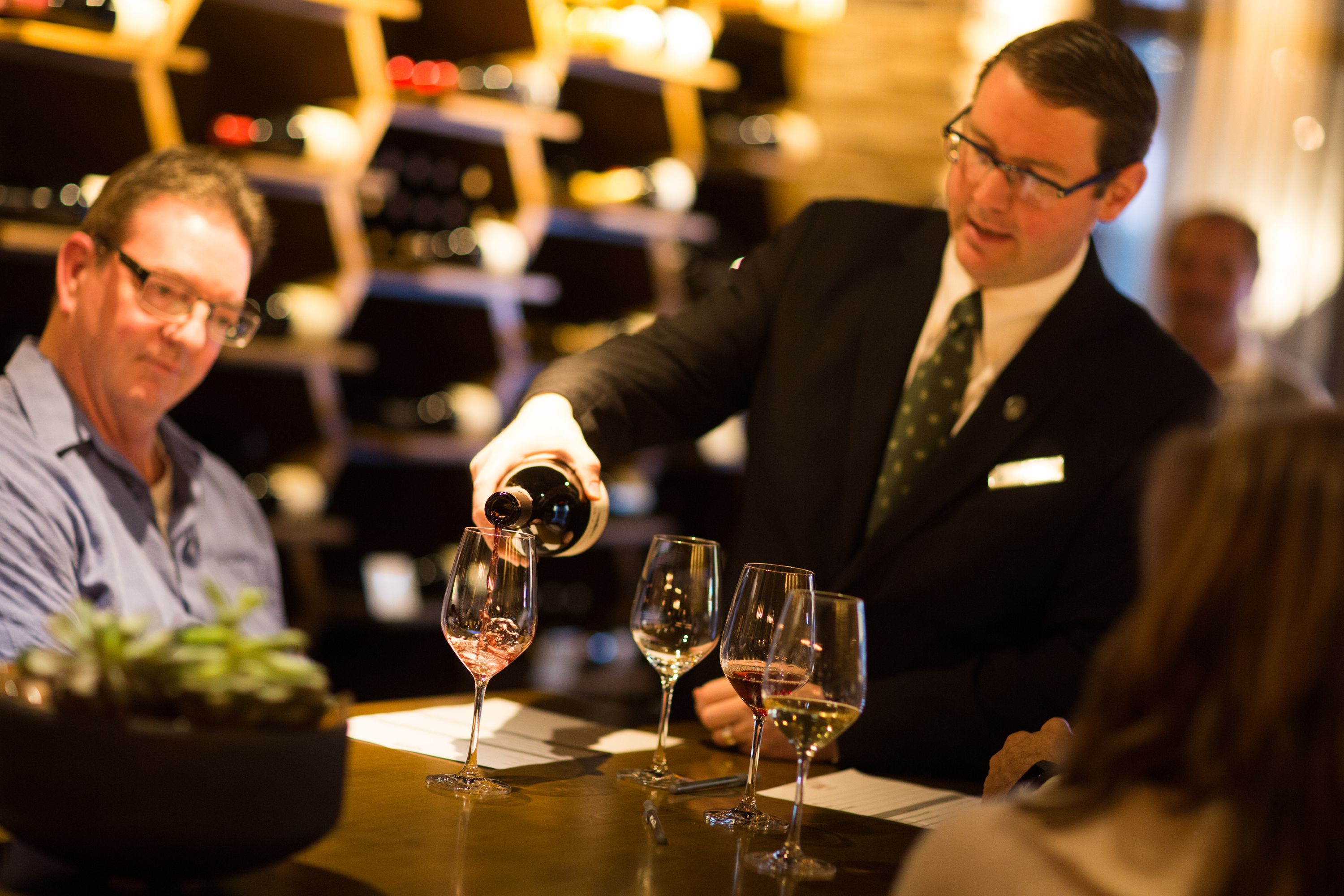 Jeff Birkemeier pours a glass of red wine for a guest at Stave Wine Cellar