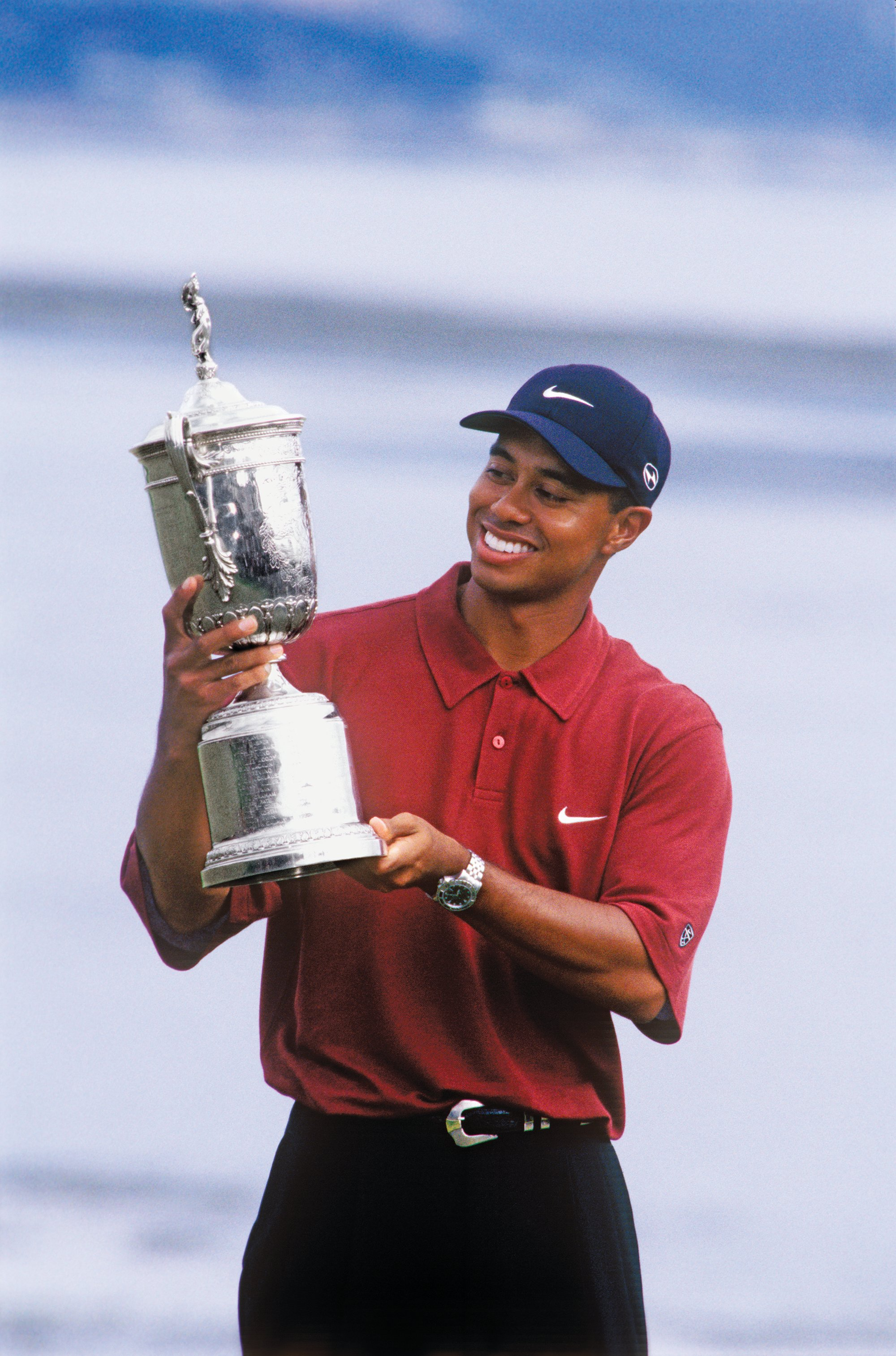 tiger_woods_with_trophy_1_c_pebble_beach_company_edit