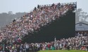 crowd in stands at golf tournament