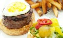 Egg on a burger and fries