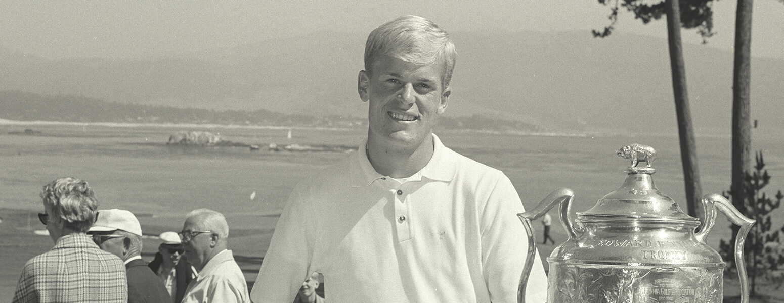 Johnny Miller stands with trophy, black and white photo