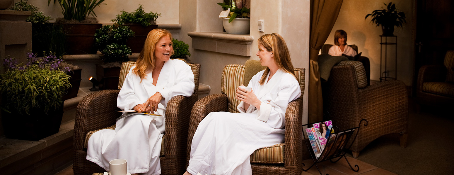 Ladies siting and chatting at spa in robes