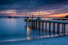 Beach and tennis club pier sunset